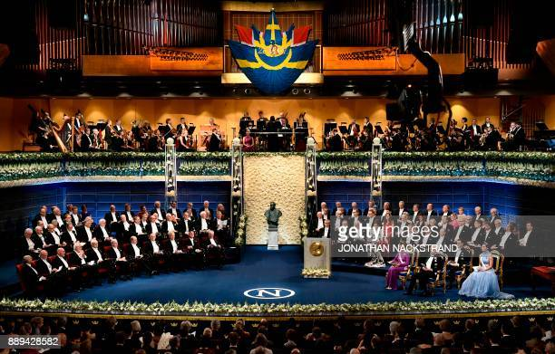 A general overview shows laureates the committee and the Swedish Royal family during the Nobel Prize Award Ceremony at the Stockholm Concert Hall on...