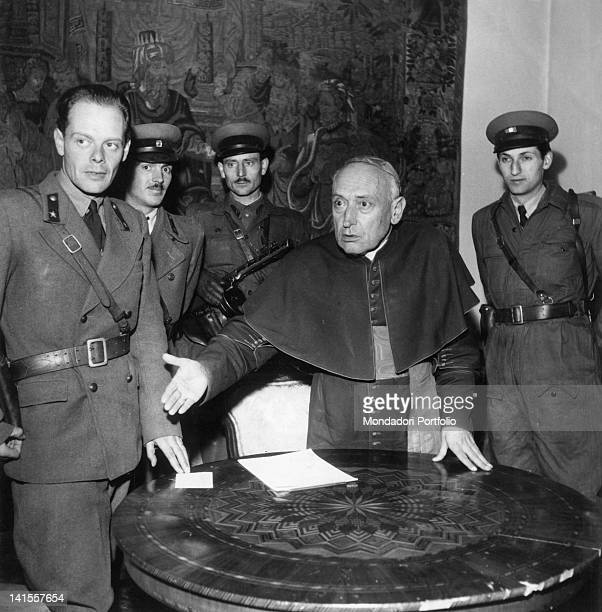 General Paul Maleter and other rebel officers talking with Cardinal Jozsef Mindszenty in a room of the archbishop's palace in Budapest Budapest...