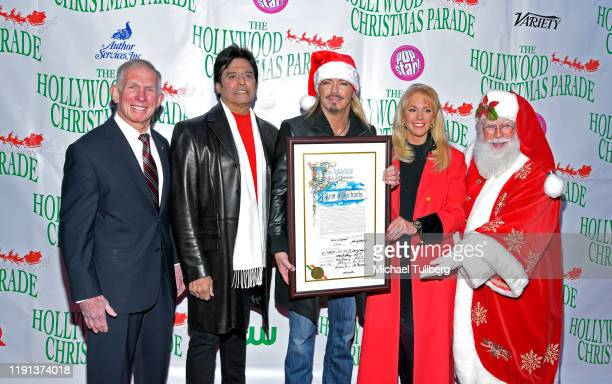 General Pete Osman Erik Estrada Bret Michaels Laura McKenzie and Santa Claus attend the 88th annual Hollywood Christmas Parade on December 01 2019 in...