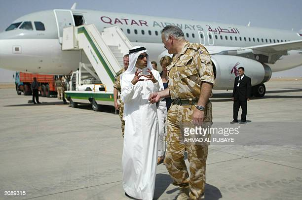 General Peter Wall commander of Britain's One Division talks to chief executive officer of the Qatar Airways Akbar alBaker in front of a Qatar...