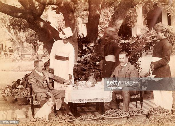 General R G Woodthorpe entertains a guest Mr W Groves with servants or khitmagars waiting at table circa 1890