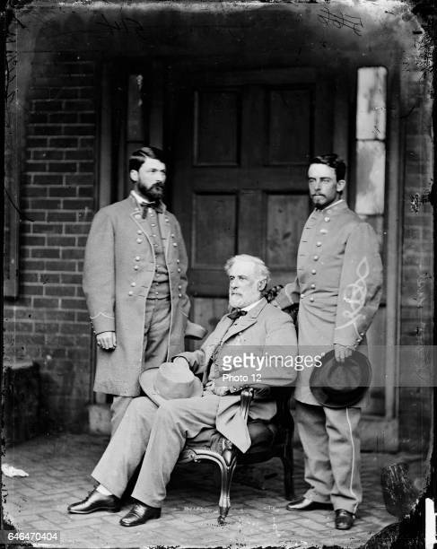 General Robert E Lee centre between his son George Washington Lee left and Colonel Walter Taylor his aidedecamp during the American Civil War 186165...
