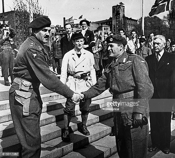 """General Roy Urquart, RA. Leader of the assualt on the Arnhem bridge in operation """"Market-Garden"""" shaking hands with Harald, Crown Prince of Norway.  ..."""