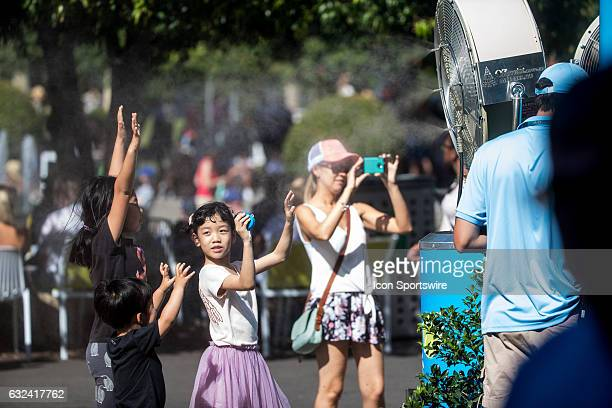 General scene of children cooling off under the misting fans located all over the place during the fourth round of the 2017 Australian Open on...