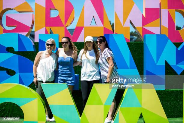 General Scene of fans having photos taken out side a big Grand Slam Oval sign during the 2018 Australian Open on January 17 at Melbourne Park Tennis...