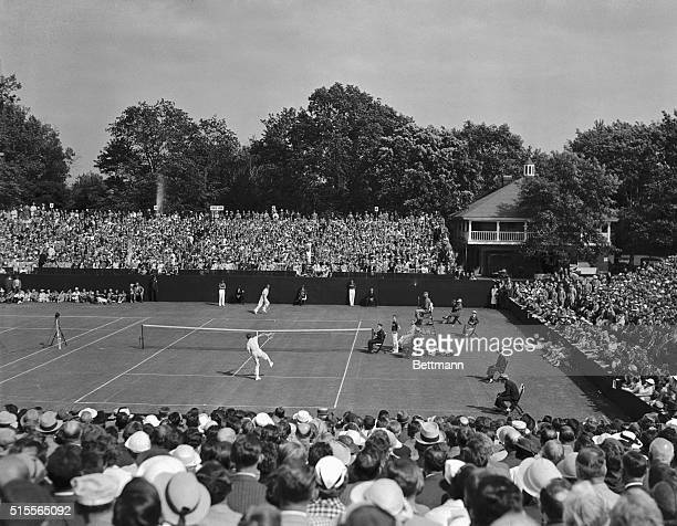 A general scene of the court and stands at the Germantown Cricket Club during the match in the Davis Cup series between Donald Budge lanky...