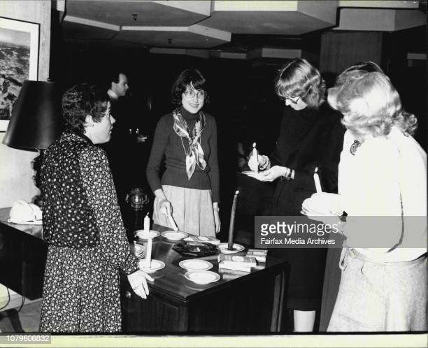 General scenes in the blacked out foyer of the Hilton Hotel as people made their way through the darkness by candlelight July 01 1980