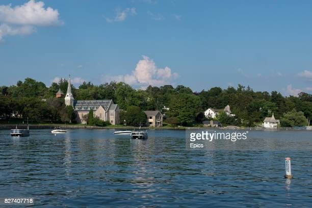 A general scenic view of the boats on the lake at the town of Skaneateles Onondaga County New York St James' Episcopal Church can be seen on the shore