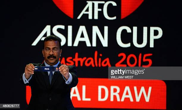 AFC General Secretary Alex Soosay displays Iraq's draw in group D during the draw of the AFC Asian Cup Australia 2015 in Sydney on March 26 2014...