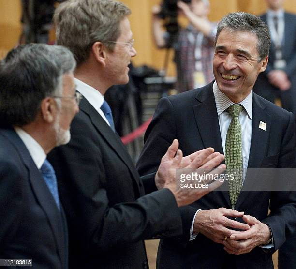 General Secretary Anders Fogh Rasmussen jokes with German Foreign Minister Guido Westerwelle at a NATO Foreign Minister meeting on Afghanistan at the...