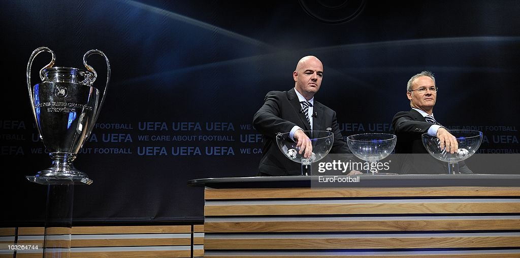 UEFA general secretary Gianni Infantino (L) and UEFA competitions director Giorgio Marchetti during the UEFA Champions League play-off draw on August 6, 2010 in Nyon, Switzerland. The play-offs are played over two legs on 17/18 and 24/25 August. The ten play-off winners will join the 22 automatic entrants in the UEFA Champions League group stage, the draw for which will be held in Monaco on 26 August 26, 2010.