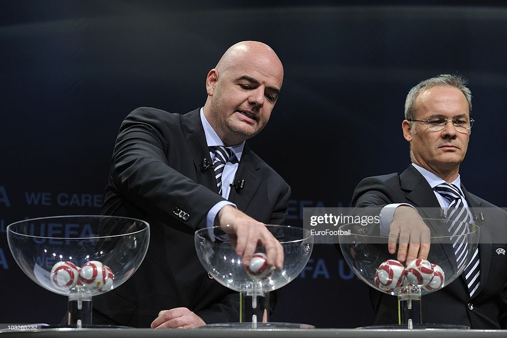 UEFA general secretary Gianni Infantino (L) and UEFA competitions director Giorgio Marchetti during the UEFA Europa League play-off draw on August 6, 2010 in Nyon, Switzerland.