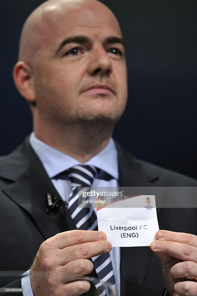 UEFA general secretary Gianni Infantino displays the name of Liverpool FC during the UEFA Europa League play-off draw on August 6, 2010 in Nyon, Switzerland.