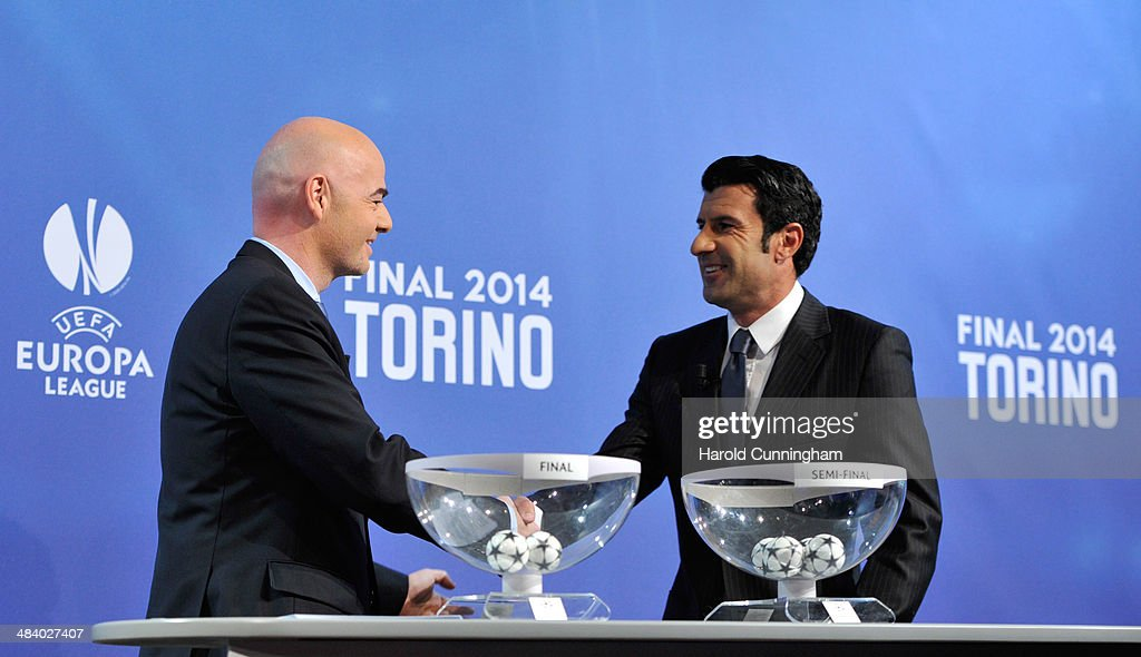 General Secretary Gianni Infantino shakes hands with Ambassador for the final Luis Figo during the UEFA Champions League 2013/14 season semi-finals draw at the UEFA headquarters, The House of European Football, on April 11, 2014 in Nyon, Switzerland.