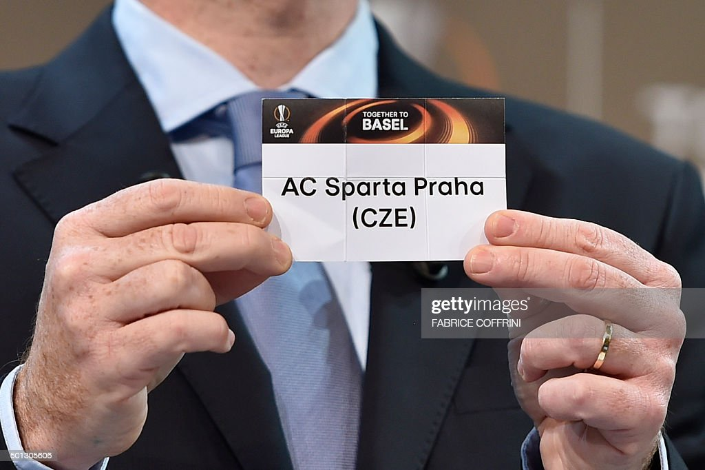 General Secretary Gianni Infantino shows the name of Sparta Prague football club during the draw for the UEFA Europa league round of sixteen, on December 14, 2015 at the UEFA headquarters in Nyon.
