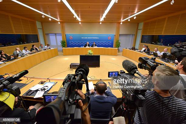 General Secretary Gianni Infantino speaks during a press conference as UEFA Head of Communications David Farrelly looks on following the Executive...