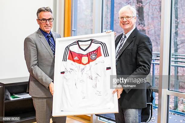 General Secretary Helmut Sandrock hands over a DFB jersey to Dr Gregor Gdawietz during Dr Gregor Gdawietz Farewell Celebration at DFB Headquarter on...