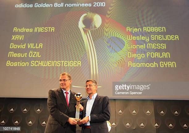 FIFA General Secretary Jerome Valcke and adidas Group CEO Herbert Hainer pose with the 'adidas Golden Ball Award Trophy' following officially...