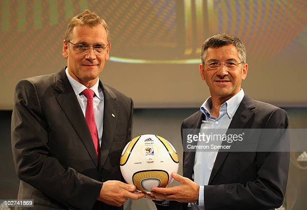 FIFA General Secretary Jerome Valcke and adidas Group CEO Herbert Hainer pose with the final match ball following officially announcing the 10...