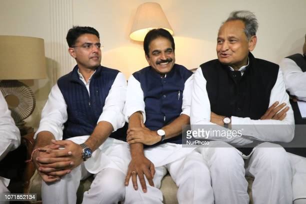 General secretary KC Venugopal flanked by Congress leaders Ashok Gehlot and Sachin Pilot after the declaration of Rajasthan Assembly election result,...