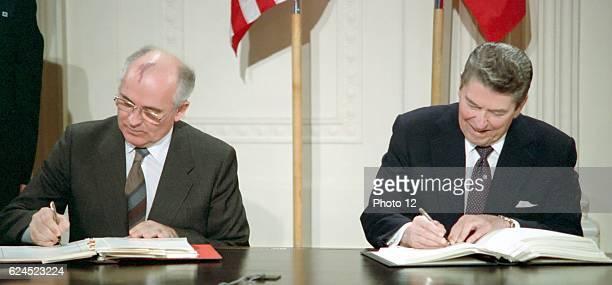 General Secretary Mikhail Gorbachev and US President Ronald Reagan sign the_IntermediateRange Nuclear Forces Treaty Washington White House December 8...