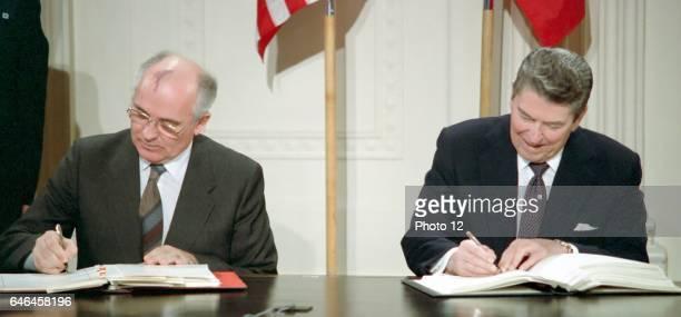 General Secretary Mikhail Gorbachev and US President Ronald Reagan sign the IntermediateRange Nuclear Forces Treaty Washington White House December 8...