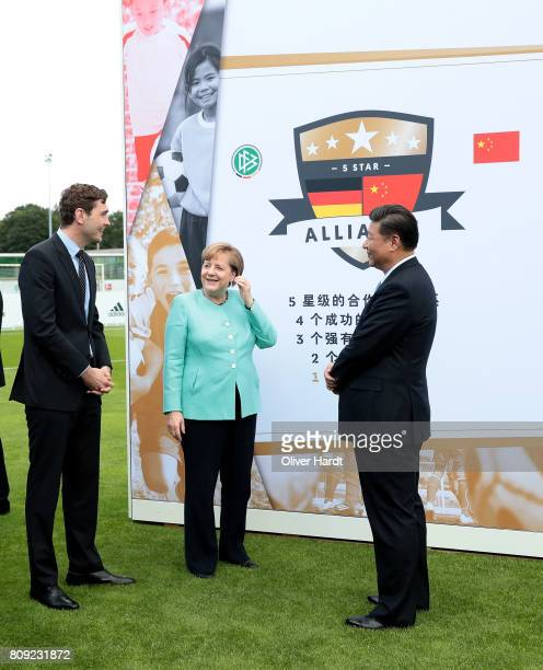 General Secretary of DFB Friedrich Curtius President XI Jinping of China and German Chancellor Angela Merkel attend the Chinese German Football...