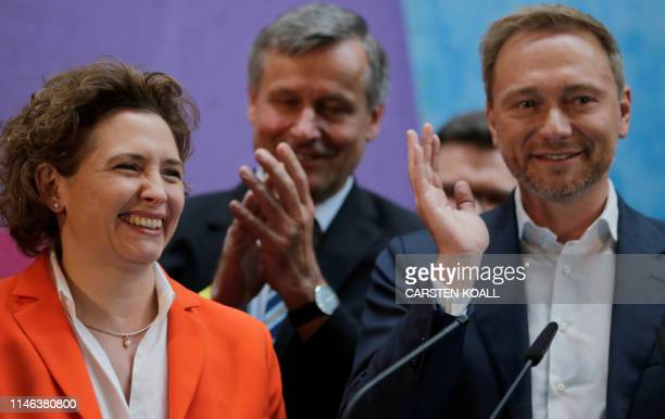 General Secretary of Free Democratic Party and top candidate for the European elections Nicola Beer, and and FDP leader Christian Lindner react after...