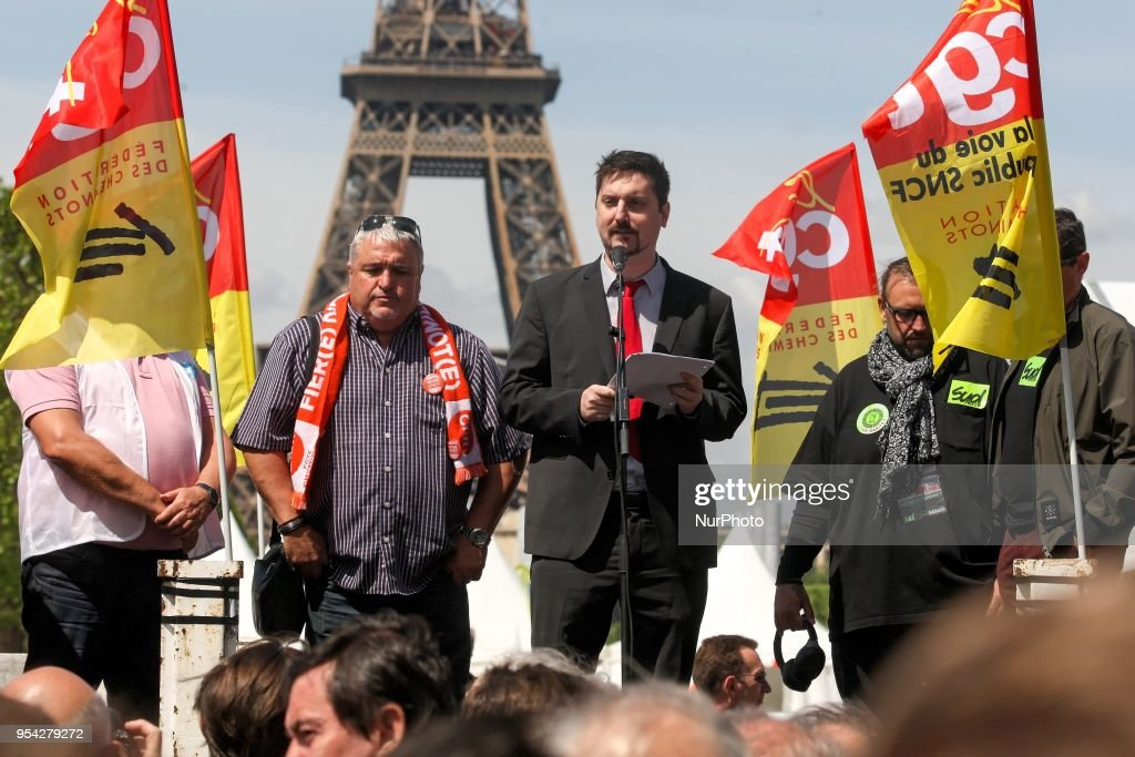 General Secretary of French workers' union CGT rail federation Laurent Brun (C), with French CFDT trade union leader Didier Aubert (L), adresses protesters during a gathering of employees of the state-owned rail operator SNCF called by CGT, Unsa, SUD, and CFDT unions on May 3, 2018 in front of the Ecole Militaire (Military Academy) in Paris, near Eiffel Tower. French rail workers will begin on May 3 and May 4, 2018, their two-day strike over planned reforms.