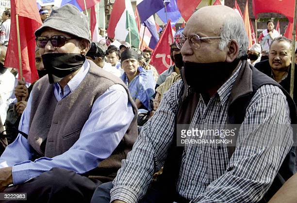 General Secretary of Nepals Congress Party Shushil Koirala and Leader of Nepal Communist PartyUnited Marxist and Leninist Party Amrit Bohara wear...