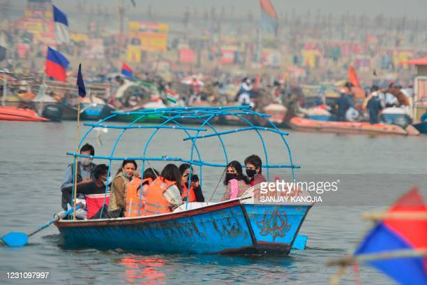 General Secretary of the All India Congress Committee party for Uttar Pradesh Priyanka Gandhi Vadra takes a boat ride after a holy dip at the Sangam...