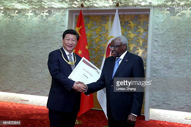 General Secretary of the Communist Party of China and the President of the People's Republic of China Xi Jinping receives the The IAAF Golden Order...