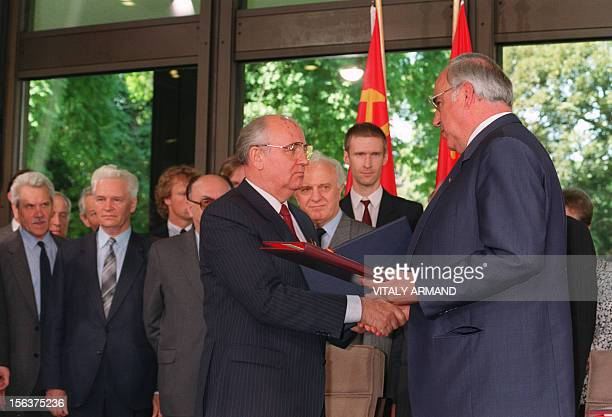General Secretary of the Communist Party of the Soviet Union Mikhail Gorbachev and German Chancellor Helmut Kohl shake hands as they exchange...