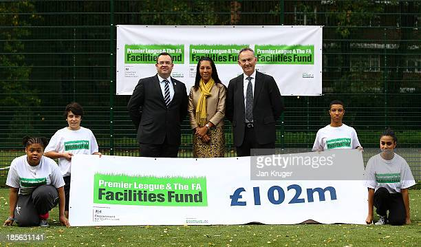 General Secretary of The FA Alex Horne Minister of Sport and Equalities Helen Grant MP and Premier League Chief Executive Richard Scudamore pose with...