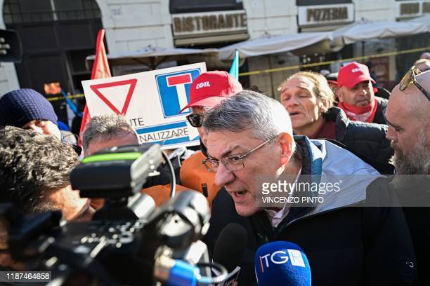 General Secretary of the Italian General Confederation of Labour Maurizio Landini addresses the media during a protest of workers and unions from all...