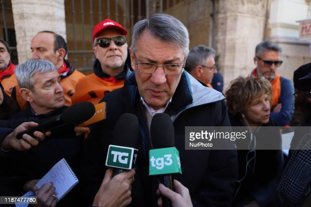 General Secretary of the Italian General Confederation of Labour Maurizio Landini addresses the media during a protest of exIlva workers from Taranto...