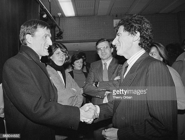General secretary of the Republican Party Francois Leotard and Minister of Culture Jack Lang shake hands before a debate on TF1 prior to the 1985...