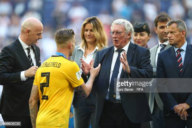 General Secretary of the Royal Belgian Football Association Gerard Linard congratulates Toby Alderweireld of Belgium on the podium prior to medal...