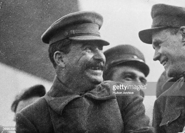 General Secretary of the Russian Communist Party Joseph Stalin on the tribune during a parade of workers