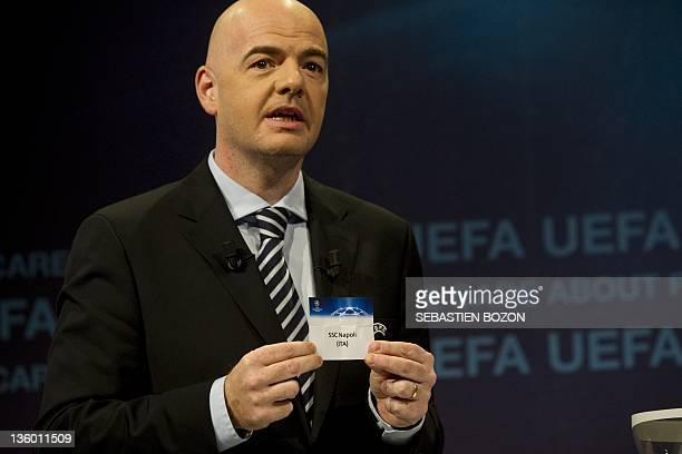 General secretary of the UEFA Gianni Infantino shows SSC Napoli's name during the draw for the last 16 of the UEFA Champions League on December 16...
