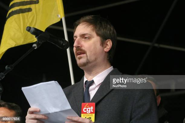 General secretary of trade union CGT of cheminots Laurent Brun attends a demonstration in front of the Gare de lEst railway station in Paris on March...