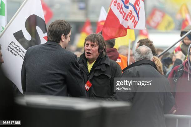 General secretary of trade union CGT of cheminots Laurent Brun speaks with former French CGT workers' union chairman Bernard Thibault during a...