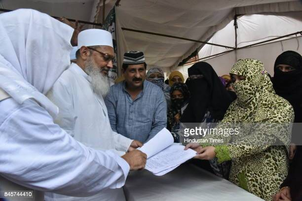 General Secretary Syed Md Wali Rahmani receives a memorandum from Muslim women during women convention at Iqbal Maidan on September 11 2017 in Bhopal...