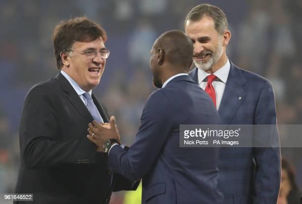 UEFA general secretary Theodore Theodoridis and Felipe VI of Spain congratulate former footballer Eric Abidal at the end of the UEFA Europa League...