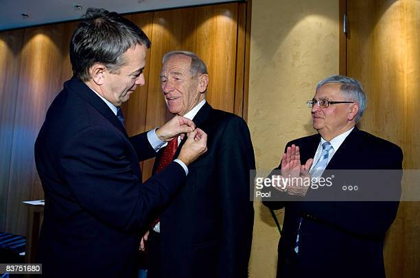 DFB general secretary Wolfgang Niersbach and President of the German Football Association Theo Zwanziger hand over a needle of honour to former...
