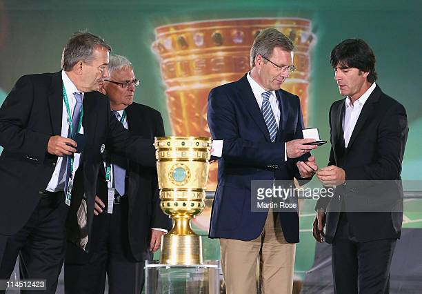 General secretary Wolfgang Niersbach, DFB president Theo Zwanziger, Federal president Christian Wulff and German national head coacj Joachim Loew...
