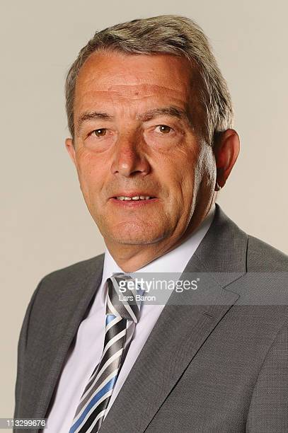 General secretary Wolfgang Niersbach poses during a German Football Association chair and board photocall at DFB headquarter on April 29, 2011 in...