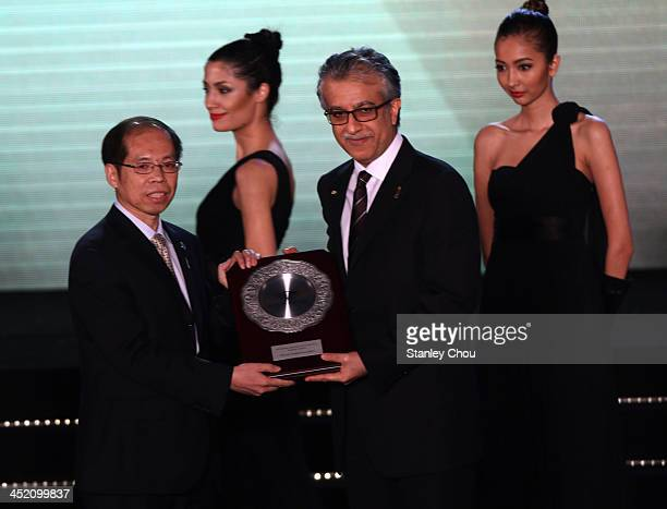 General Secretary Zhang Jian is presented the AFC Inspiring Member Association of the Year award by AFC President Sheikh Salman bin Ibrahim Al...