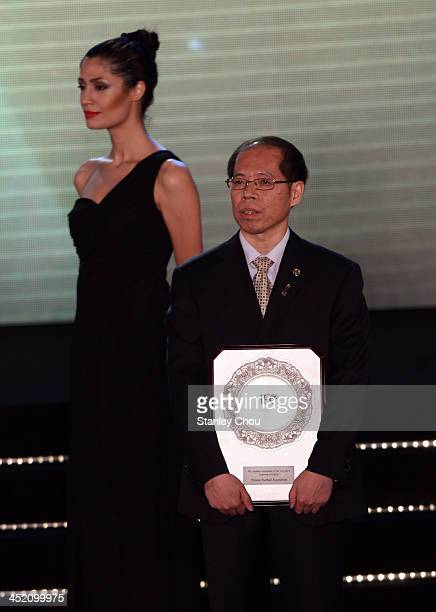 General Secretary Zhang Jian poses with the AFC 'Inspiring' Member Association of the Year award during the 2013 AFC Annual Awards at the Mandarin...