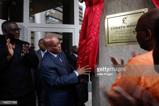 COSATU General Secretary Zwelinzima Vavi and President of COSATU Sidumo Dlamini applaud as South African President Jacob Zuma unveils a plaque as he...